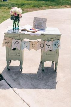 I love how the desk is vintage but still country-ish. This would work perfect before guests walk through the barn doors.