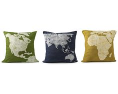 "CONTINENT PILLOWS-SET OF 3  $ 95.00 ""Rest your head close to home or drift off to far away lands with the world map pillows. Either way, you can rest assured that these bright & cheery pillows help the greater good by providing fair wages & development opportunities for artisans in South West India. Pillow cases are made of cotton & decoration is applied using Batik, a traditional Indian art to create patterns on fabric. Set of three pillows. Handmade in India."""