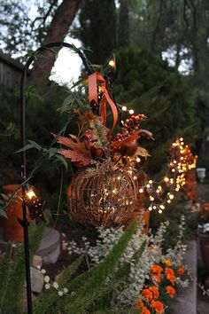 Fall Decorations: Designer Melissa Valeriote modified a Grapevine Twig Pumpkin decoration from The Home Depot to be an enchanting outdoor fall lantern. Click through to see more of her gorgeous outdoor decorations.    @valeriotedesign