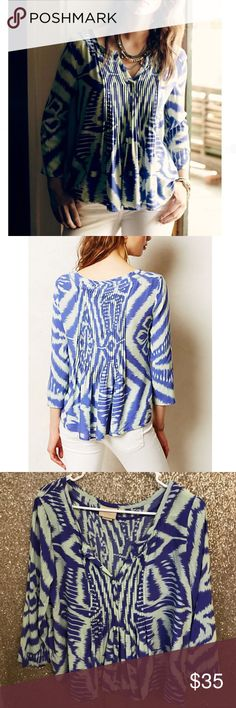"""Anthropologie Sz 12 Vanessa Virginia Ikat Top EUC 🔹Vanessa Virginia from Anthropologie   🔹Ikat Pintucked Peasant Top  🔹Size 12  🔹Excellent used condition!   🔹Rayon  🔹Bust: 21.25"""" across the front, lying flat.   🔹Length: 23"""" from shoulder to hem.   ✳️ Bundle to Save 20%!  ❌ No Trades, Holds, PP, Modeling  🎀 100% Authentic!   ⭐️⭐️ Suggested User • 3000+ Sales • Fast Shipper • Best in Gifts Party Host! ⭐️⭐️ Anthropologie Tops"""