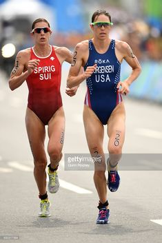 Nicola Spirig Hug of Switzerland and Gwen Jorgensen of the United States run during the Women's Triathlon on Day 15 of the Rio 2016 Olympic Games at Fort Copacabana on August 2016 in Rio de Janeiro, Brazil. (Photo by Quinn Rooney/Getty Images) Rio Olympics 2016, Summer Olympics, Gwen Jorgensen, Triathlon Swimming, Triathlon Women, Triathalon, Runners World, Runners High, Athletic Events