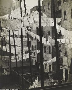 Wash day: Huge numbers of sheets and other laundry items criss-cross the gap between tenements in New York in 1937. Photo by Consuelo Kanaga-The Jewish Museum.
