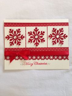 handmade Christmas card .. red and white ... red punched snowflakes and snowflake border trim ... three panels design ... pretty card!