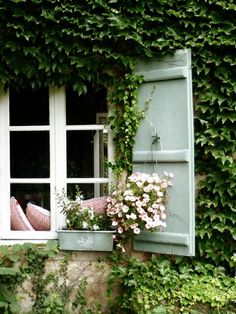 Ivy covered French house with hanging baskets... I love everything about this, I've always loved ivy covered buildings