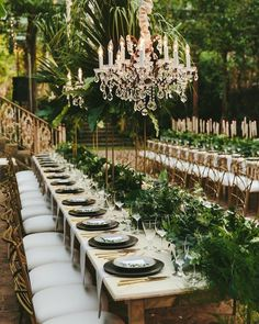 Long outdoor wedding table with greenery runner Tablescape Reception decor with hanging chandeliers Stylish Greenery Wedding in Maui Hawaii Perfete Outdoor Wedding Tables, Long Table Wedding, Wedding Reception, Outdoor Weddings, Wedding Seating, Wedding Table Planner, Wedding Planning, Event Planning, Wedding Themes