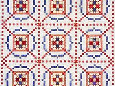 Red, white and blue Burgoyne Surrounded quilt with star centers