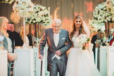 Tatton Park Wedding Photographs – An emotional bride and her grandfather walking down the aisle. Jenny Packham wedding dress, bouquet and venue flowers by Red Floral Architecture. photo by tobiah tayo photography - available for commissions worldwide www.tobiahtayo.com