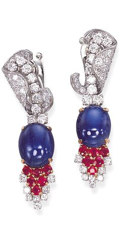 A PAIR OF SAPPHIRE, RUBY AND DIAMOND EAR PENDANTS, BY MARCHAK Each set with a cabochon sapphire, to the circular-cut ruby and diamond cluster terminal, suspended from a circular-cut diamond line top enhanced by a pavé-set diamond C-shaped scroll, with French assay marks for platinum and gold Signed Marchak