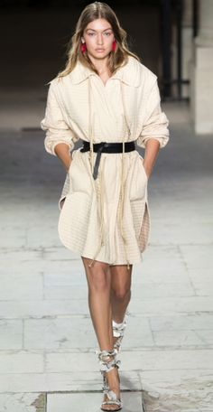 Shop now. Isabel Marant Boyd Quilted Cotton Coat. Gigi Hadid. 'Ready-to-wear in the truest sense,' was how Vogue Runway's Chioma Nnadi summed up Isabel Marant's SS17 collection. This quilted cotton coat – as seen on Gigi Hadid, who opened the show – exemplifies Marant's boho/rock-chick Paris/sports-luxe aesthetic. Cut for an oversized fit, the coat fastens with concealed buttons, has pockets and a waist cinched in by a drawstring and dark brown leather belt.