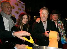 Serafina Ludlow Opening Party from Party Pics: New York  Alec Baldwin helps cut the pasta ribbon.
