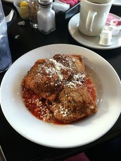 Meglio's Restaurant had a makeover done by Chef Robert Irvine and the Restaurant Impossible show. This is his freshly made raviolis. Delicious.