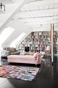 Built-in bookshelf and pink chaise.