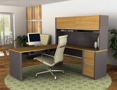 Modern office---cubicle design ideas. Notice the round floor mat that encompasses the entire space.