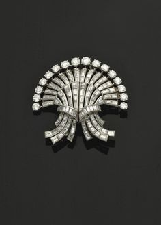 A DIAMOND, PLATINUM AND GOLD DOUBLE CLIP BROOCH, BY BOUCHERON - 1950s. | Christie's