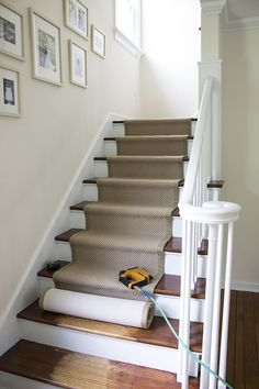 Stair Runner DIY with Sisal Rugs Direct Room for Tuesday Haus Dekoration Stairs Makeover Dekoration Direct DIY Haus Room Rugs Runner Sisal stair Tuesday Stair Renovation, Staircase Runner, Stairs With Carpet Runner, Striped Carpet Stairs, Hardwood Stairs, Stairs Flooring, Floors, White Stairs, Staircase Makeover