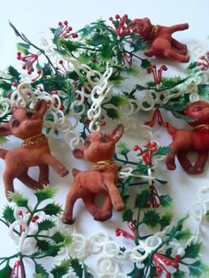 vintage Christmas garland, fuzzy deer, white plastic chain, green holly branches, red berries, Christmas decor, tree garland, decorations
