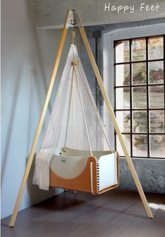 According to some, a hanging crib makes the transition from womb to world a little easier for your baby. Suspended cradlesImage viaThe hanging cradle provides a Baby Bassinet, Baby Cribs, Baby Bedroom, Kids Bedroom, Baby Bedding, Hanging Cradle, Hanging Crib, Mini Greenhouse, Baby Swings