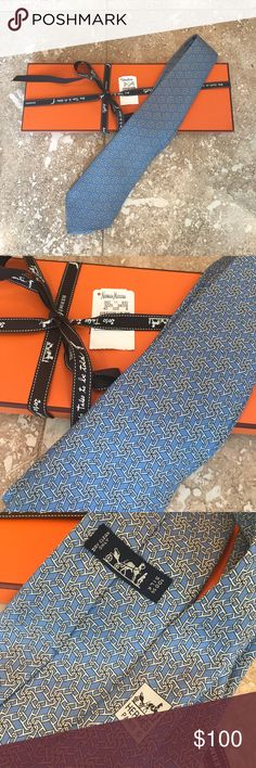 Hermes Tie 100% Silk Blue and Grey With Box & tag Impeccable condition with Neiman Marcus tag (price removed - it was $195.00).  Blue silk with grey link pattern.  Box and ribbon included - not one stain!!!  Like new!!!  Worn only 2 times!  Price firm. Hermes Accessories Ties
