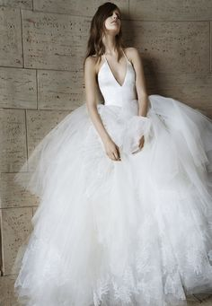 Look 16. Ivory deep V-neck silk charmeuse halter ball gown with ruched tulle skirt and Chantilly lace appliqué accents.
