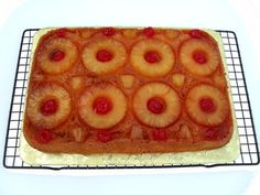 Pineapple Upside-Down Cake simplified with a cake mix and kicked up a notch with the addition of rum in the brown sugar topping. Super moist. Super delicious. Super duper. Need I say more? Easy P…