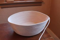 Skip the fabric covering and use metallic thread to form clothesline baskets and bowls.  http://onmyhonoriwilltry.blogspot.com/2012/01/cotton-clothesline-baskets.html
