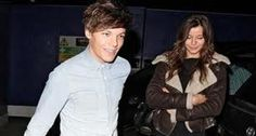 Suspender and toboggan wearing One Direction member Louis Tomlinson surprised his girlfriend this morning before Eleanor Calder before she took her exam for school . Louis' family also wished her the best . How did Louis surprise her?