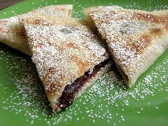 Chocolate Quesadillas !!!! All that is needed is: Chocolate Chips (regular or mini), cinnamon sugar, flour tortillas and powdered sugar