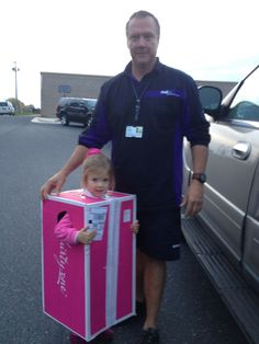 Special Delivery!! Halloween Cuteness!  Daddy dressed up as a FedEx guy.
