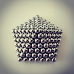Tutorial on how to make a spinning top from zen magnets, buckyballs, neocube. Transform your magic balls into a spinner.