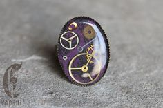 Steampunk Neo Victorian Bronze Adjustable Ring with Antique Watch Gears and Cogs on Purple Damask Background