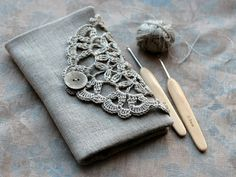 A romance with crochet hooks ;).  Linen Crochet Hook Case  Holder  Organizer by namolio on Etsy,