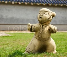"""Buy the royalty-free Stock image """"Funny traditional Thai garden scuplure Demonstrating military art"""" online ✓ All image rights included ✓ High resolutio. Garden Statues, Garden Sculpture, Tree Pruning, Chinese Boy, Military Art, Amazing Gardens, Garden Inspiration, Online Art, Garden Art"""