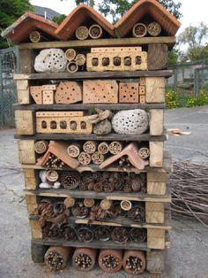 I like the pillar style bug hotels. Really interesting yard art.  I want one for the kiln gods.