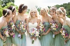 Sage green bridesmaids dresses compliment the beautiful bride - thereddirtbride.com - see more of this wedding here