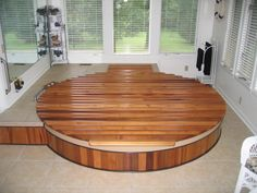 Great Northern® Rubadub Tub® Hot Tub-Hot Water Therapy Tub with wooden Roll-Up® Cover sunken in the floor for easy entry and exit. Round Hot Tub, Wood Tub, Hot Tub Cover, Backyard Layout, Spa Rooms, Western Red Cedar, Wooden Flooring, Hot Tubs, Therapy