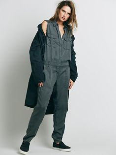 Gunner Utility One Piece | Utility jumpsuit with two breast pockets and two side waist pockets. Hidden button closures. Raw trim detailing. Belt loops around the waist. *By Etienne Marcel