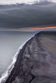 Iceland's volcanic beach at sunset