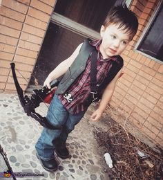 Rachel: Rowan (2 1/2 years old) dressed as The Walking Dead's Daryl Dixon. Hand drawn wings on bleached denim for the motorcyle vest. Crossbow made out of a dollar store bow...