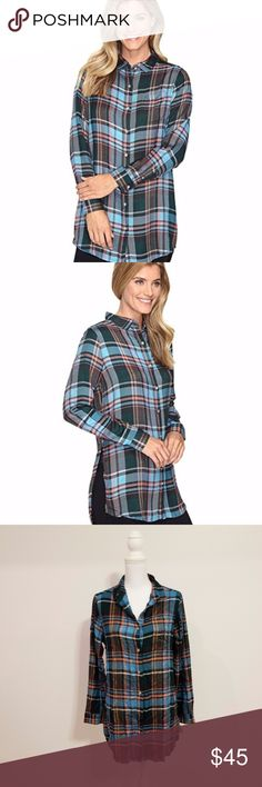 JAG Turquoise Plaid Magnolia Tunic SMALL Create a gorgeous look perfect for layering with your favorite jeans. Relaxed fit tunic top boasts an allover yarn-dyed plaid on a lightweight woven fabrication. Fold-over collar. Long sleeves sport double-button cuffs. Left chest pocket. Curved back yoke with center button detail. Shirttail hemline sports dramatic side splits.  From smoke and pet free home. JAG Tops Tunics