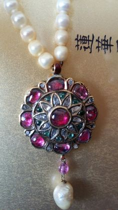 Natural pearls and ruby, emeralds and diamond pendant. 18th C