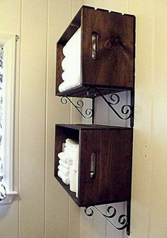 Wood boxes and scrolled, wrought iron shelf brackets.