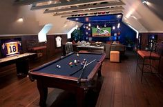 Ever thought of converting your attic game room into a luxurious man cave? This is an awesome example! #attic #gamesroom #mancave