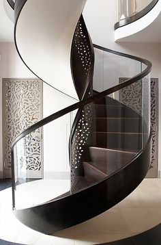 The ideas on spiral staircase design you are about to see cover different styles, yet mostly modern and contemporary, and those are the preferred styles for new homeowners. Stair Handrail, Staircase Railings, Curved Staircase, Stairways, Spiral Staircases, Staircase Runner, Staircase Remodel, Railing Design, Staircase Design