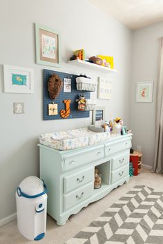 Pegboards aren't just for hardware or craft storage. Hang one up in your child's room and use caddies to store diapers, toiletries, or socks and other accessories.  From Paper Dolls Design   - HouseBeautiful.com