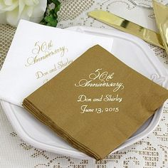 Anniversary cocktail napkins printed with napkins Placement A, VW50 anniversary design, and two lines of text in Florentine Cursive lettering style