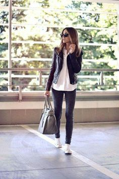 Converse, a great white blouse, and leather. Casual class with a touch of funk.