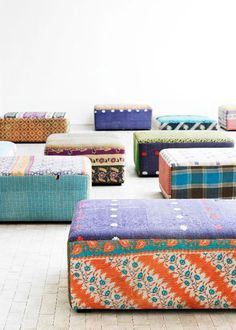 We love vintage- so the idea of repurposing antique quilts into upholstered ottomans really strikes our fancy!