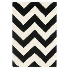 Wool rug with a chevron motif. Hand-tufted in India.  Product: RugConstruction Material: WoolColor: Ivory and blackFeatures: Handmade in India Note: Please be aware that actual colors may vary from those shown on your screen. Accent rugs may also not show the entire pattern that the corresponding area rugs have.