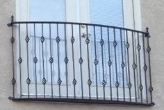 Wrought iron Balconies. Fancy baskets iron balcony fromw www.deciron.com they ship nationwide!