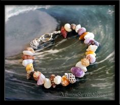 "Monica's Sunrise Shells of the North Shore, O'ahu, Hawai'i ... Pure Hawaiian seashell love, this beautiful bracelet is ""wearable Aloha"" with a unique variety of shell colors, textures, shapes and patterns. Natural beach jewelry at its finest.   Hand made with Aloha on the North Shore, Haleiwa, Hawaii."